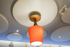 Ceiling lamp. Close up creative designed orange ceiling lamp Royalty Free Stock Image