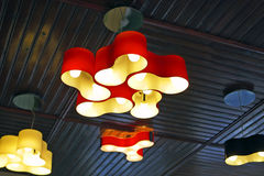 Ceiling lamps. Dark-ceiling room illuminated by colorful decorative lamps stock images
