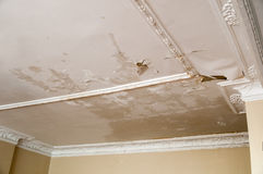 Ceiling Leakage. Horizontal photo of a leaking ceiling. The leakage ruin the ceiling painting and makes a wet and messy look Stock Images