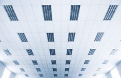 Ceiling at lecture hall. Specialy with soft blue tint royalty free stock images