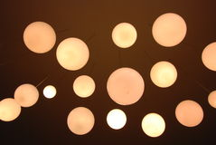 Ceiling light ball. They are light ball hold down from ceiling in coffee shop Royalty Free Stock Photos