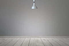 Ceiling light in the room and light shining to wall and floor. Stock Image