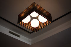 Ceiling Light. Wooden square ceiling pendant with four lights Royalty Free Stock Images