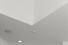 Ceiling and lighting inside office building. Ceiling light closeup Stock Photos