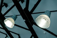 Ceiling lights on a metal grid stock photo