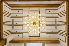 Ceiling in living room with beautiful chandelier Stock Images