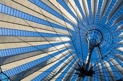 Ceiling of the mall in Potsdamer platz, Berlin, Germany. A modern installation cover the mall in Potsdamer platz in Berlin, allowing to see through an intense Royalty Free Stock Image