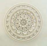 Ceiling Medallion. A vintage ceiling medallion with intricate patterns Stock Photography