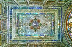 Ceiling in mirror hall of Qavam House, Shiraz, Iran. SHIRAZ, IRAN - OCTOBER 12, 2017: The colorful ceiling in mirror hall of Qavam Ghavam House in Naranjestan is Stock Photos