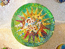 Ceiling with mosaic sun of Park Guell. Designed by Antonio Gaudi in Barcelona. Part of the UNESCO World Heritage Site Works of Antoni Gaudi royalty free stock image