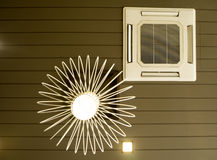 Ceiling mounted cassette type air conditioner and chandelier.  Stock Images
