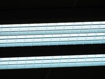 Ceiling of office building with lights. Industry house with blue  toned lighting Stock Photos