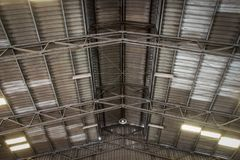 The ceiling of old warehouse with sport lights. lens flare. Texture background stock images