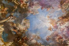 Ceiling painting in Palace of Versailles. PARIS, FRANCE - MARCH 28 2018: Ceiling Painting in Hercules Room of the Palace of Versailles on March 28,2018 in Paris royalty free stock photos