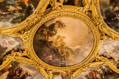 Ceiling painting in Palace of Versailles. PARIS, FRANCE - MARCH 28 2018: Ceiling Painting in Hercules Room of the Palace of Versailles on March 28,2018 in Paris stock photos