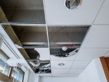 Ceiling panels damaged and collapsed by water. Rainwater leakage damage stock photography