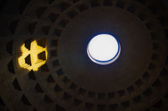 Ceiling of Pantheon. With round opening and sunlight spot stock image