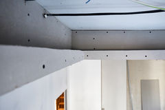 The ceiling of plasterboard. The installation of the suspended plasterboard ceiling in the apartment stock images
