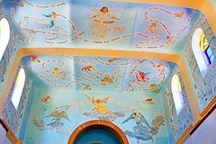 Ceiling and rood-loft painting in the church in the monastery of Dir Rafat Regina Palestina. With the inscription Ave Maria in 323 languages, Israel stock image