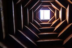 Ceiling in room. Ceiling design made ​​of wood in the form of a pyramid, room metidatsii Stock Images