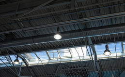 Ceiling of the room with a metal construction and ventilation Royalty Free Stock Images