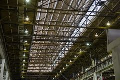 Ceiling slabs in industrial buildings, roof steel structure with lamps of modern warehouse or factory.  Royalty Free Stock Photo