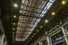 Ceiling slabs in industrial buildings, roof steel structure with lamps of modern warehouse or factory Royalty Free Stock Photos