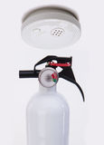 Ceiling Smoke Detector and extinguisher Royalty Free Stock Photo