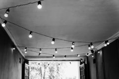 The ceiling in the street cafe is decorated with a garland with royalty free stock photo