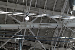 Ceiling in a warehouse. Ventilation and illumination stock photography