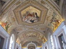 Vatican City has many beautiful frescoes and mosaics. The ceilings and walls within Vatican City have many gorgeous frescoes and mosaics displayed. Religious stock photography