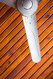 Ceilling fan. On the wooden ceilling stock photo