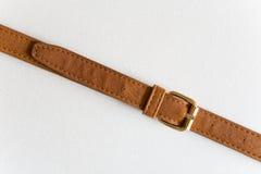 Ceinture en cuir de Brown avec une boucle Images stock
