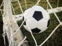 Cel! Futbol z tyłu sieci! Obrazy Royalty Free