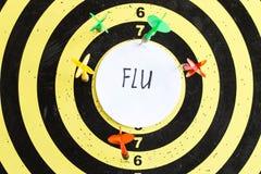 Cel z strzałkami w centrum z czego wpisowa grypa obraz stock