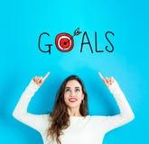 Cele z młodą kobietą patrzeje upwards obraz stock