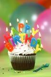 Celebración con las velas y la torta de los globos Imagenes de archivo