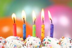 Celebración con las velas y la torta de los globos Imágenes de archivo libres de regalías