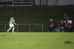 Celebración de la meta capturada por los fotógrafos de los deportes Imagen de archivo