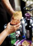 Celebración del éxito con un vidrio de vino Fotografía de archivo libre de regalías
