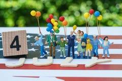 Celebración del Día de la Independencia con el famil americano feliz miniatura Imagenes de archivo
