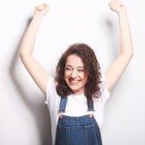 celebración extática feliz de la mujer siendo un ganador Foto de archivo libre de regalías