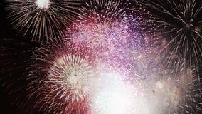 Celebración y fondo de las explosiones de los fuegos artificiales metrajes