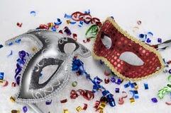 Celebraciones, máscaras rojas y de plata del partido Foto de archivo