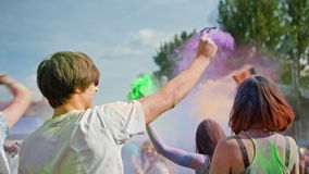 Celebrants dancing during the color holi festival stock video footage