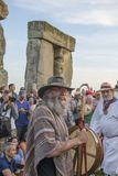 Stonehenge Summer Solstice. Celebrants at runs of Stonehenge during Wiltshire Summer Solstice observance royalty free stock image