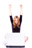 Celebrate. Blond beautiful woman celebrating on the laptop stock photography