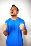Celebrate. Young man holding his arms in celebration royalty free stock photo