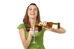 Celebrate. Twenty something woman pretends to pour a glass of wine. Empty glass you can fill with your own liquid. More of this model in my portfolio Royalty Free Stock Image