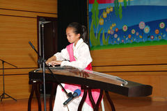 Celebrate Children's Day:playing guzheng Stock Image